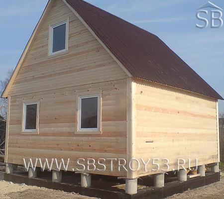 Двухэтажный дом из бруса. Размер: 6х5 м.